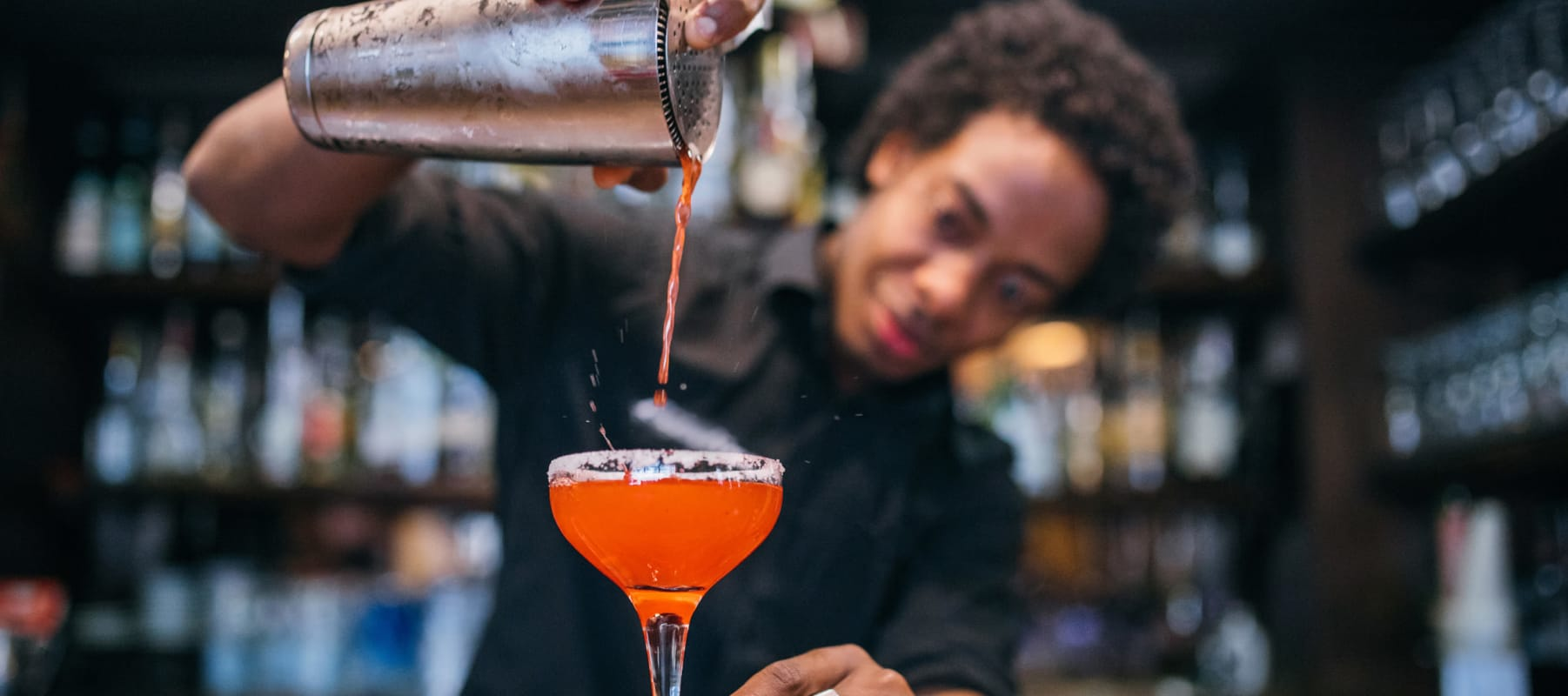 Bartender pouring a mouth-watering cocktail at a bar near 17th Street Lofts in Atlanta, Georgia