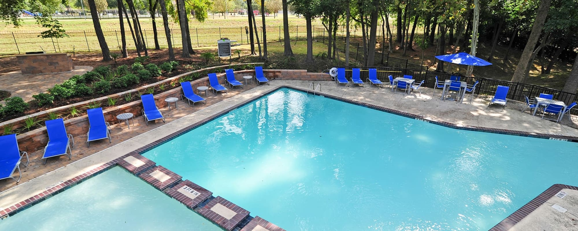 Beautiful swimming pool and chairs at Bayou Parc at Oak Forest in Houston, Texas