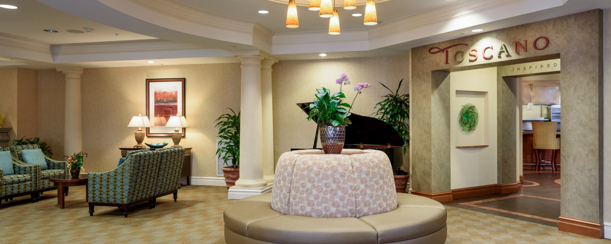 Common area with a piano at The Bellettini in Bellevue, Washington