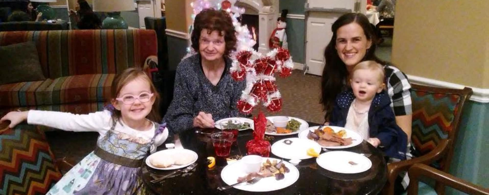 Seniors eating with children at The Charleston at Cedar Hills in Cedar Hills, Utah