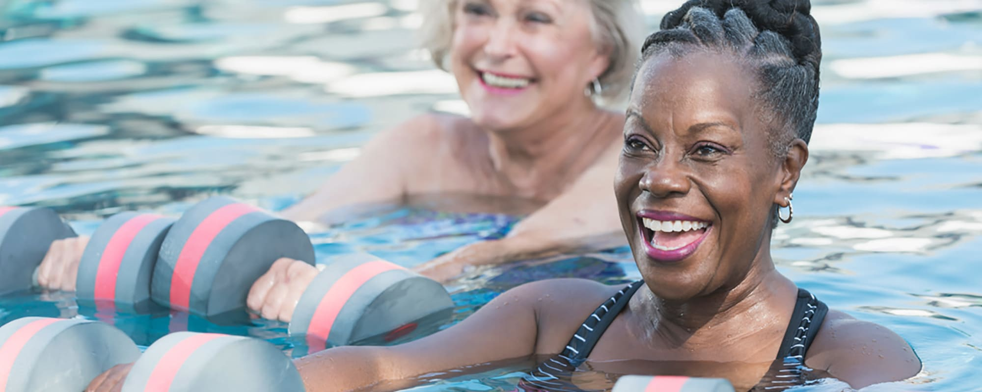 Residents exercising in the pool at one of our communities at All Seasons Senior Living in Farmington Hills, Michigan