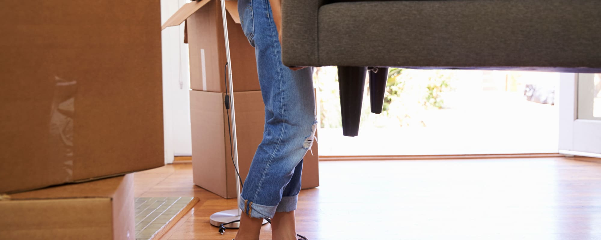 Woman moving sofa to A3 Storage Centers in Midland, Texas