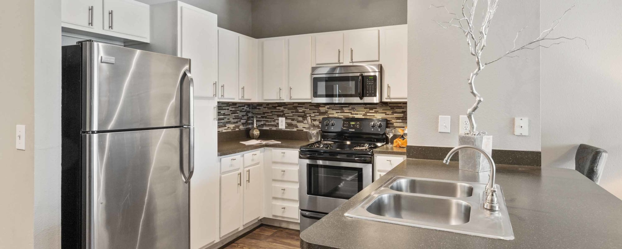 Kitchen with stainless appliances at Archer Stone Canyon