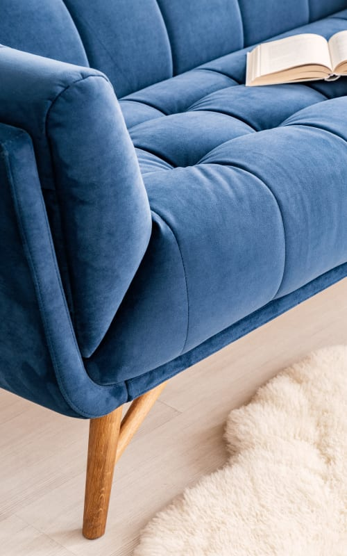 Blue couch at Jaybird Senior Living