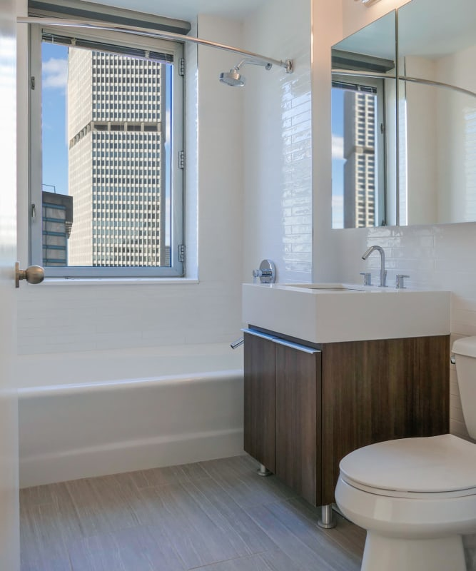 A bathroom with an oval tub at The Metropolis in New York, New York