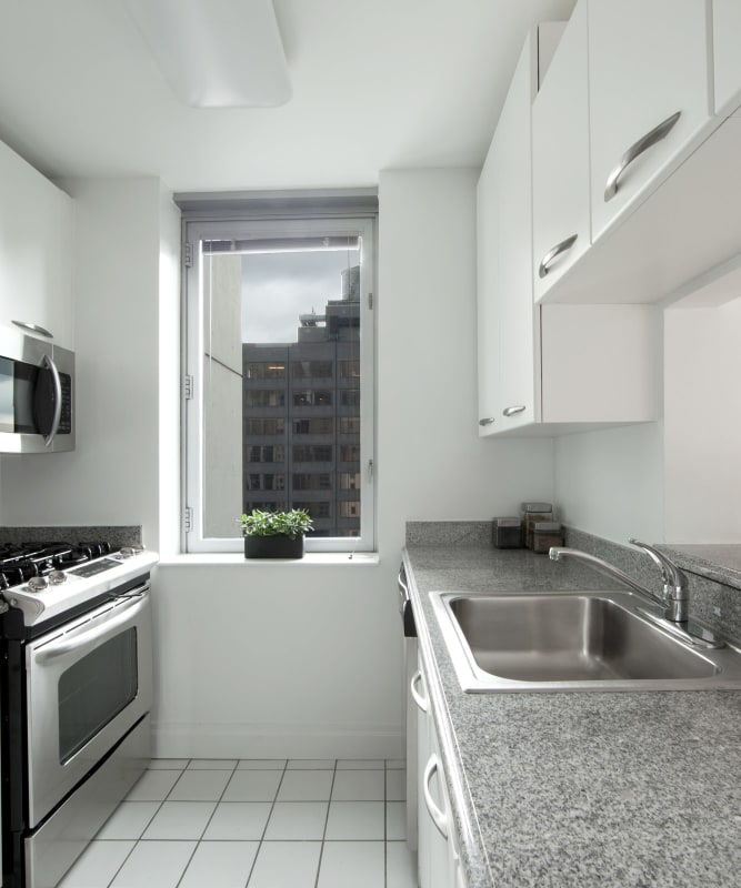 A kitchen with tile flooring at The Metropolis in New York, New York