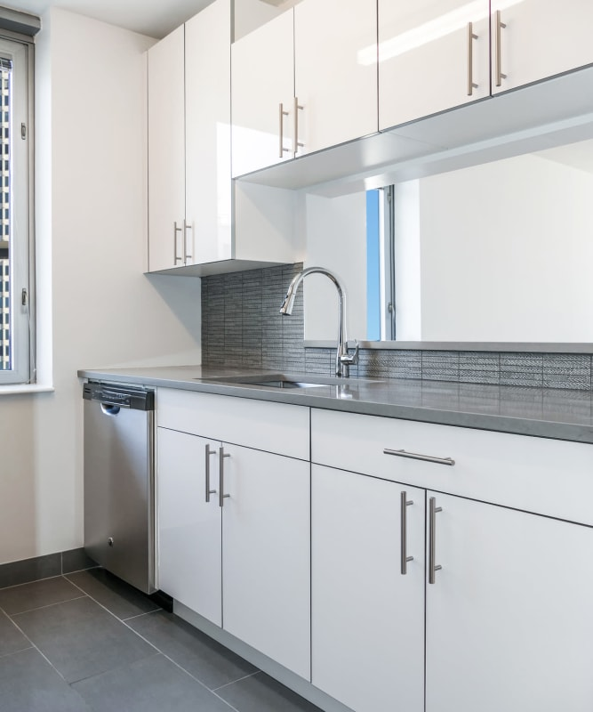 A kitchen with modern cabinets at The Metropolis in New York, New York