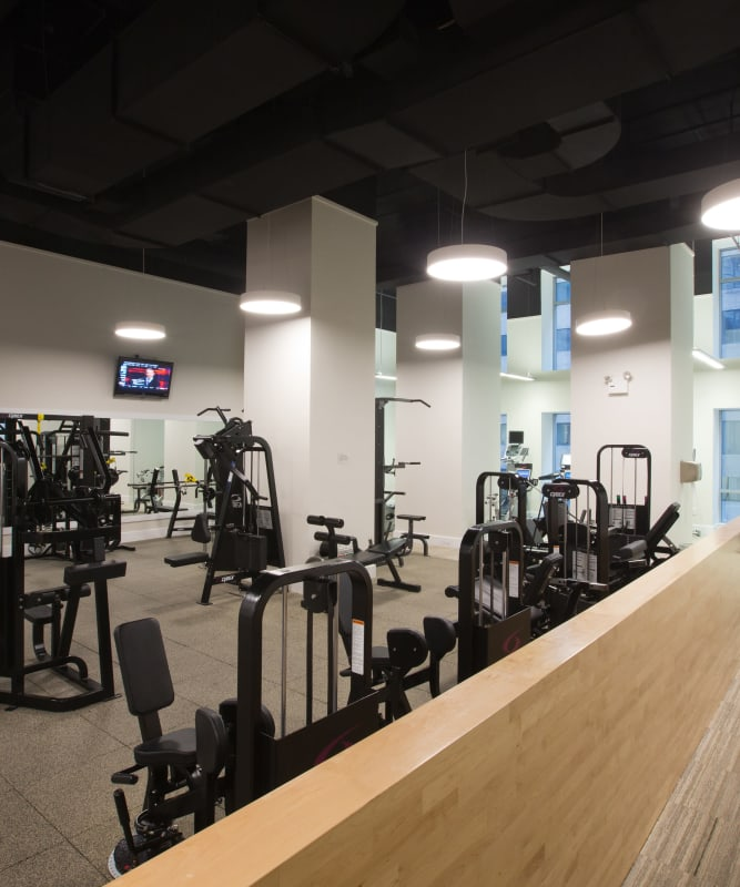 A fitness center with plenty of workout stations at The Metropolis in New York, New York