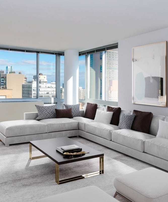 A spacious living room with lots of windows at The Metropolis in New York, New York