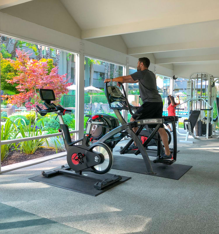 Resident enjoying the view while working out at Palo Alto Plaza in Mountain View, California