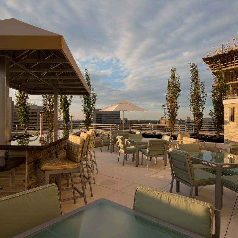 A rooftop lounge with bar seating at Solaire 1150 Ripley in Silver Spring, Maryland