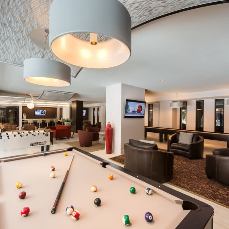 Lounge with Pool Table, Seating, and Other Games at  in Silver Spring, MD