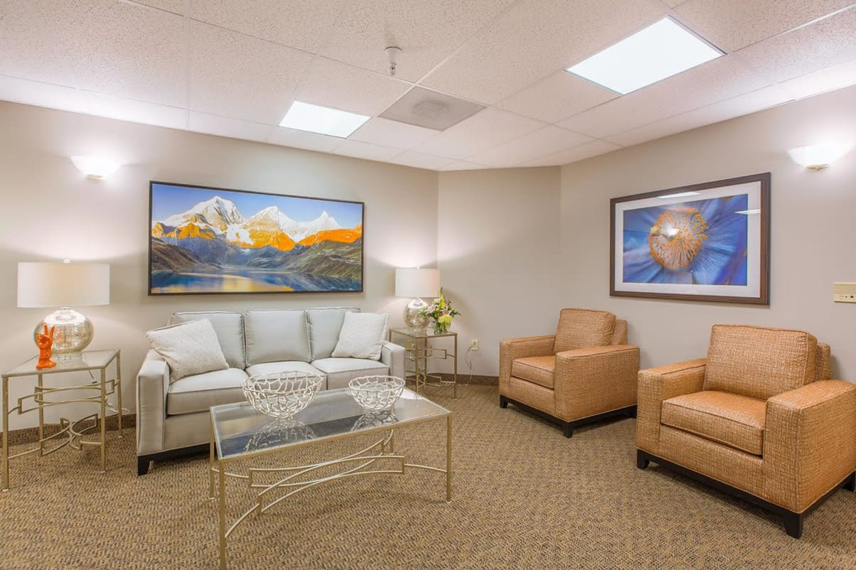 Comfortable chairs and couch for residents with fireplace at Sun Terrace Hermiston