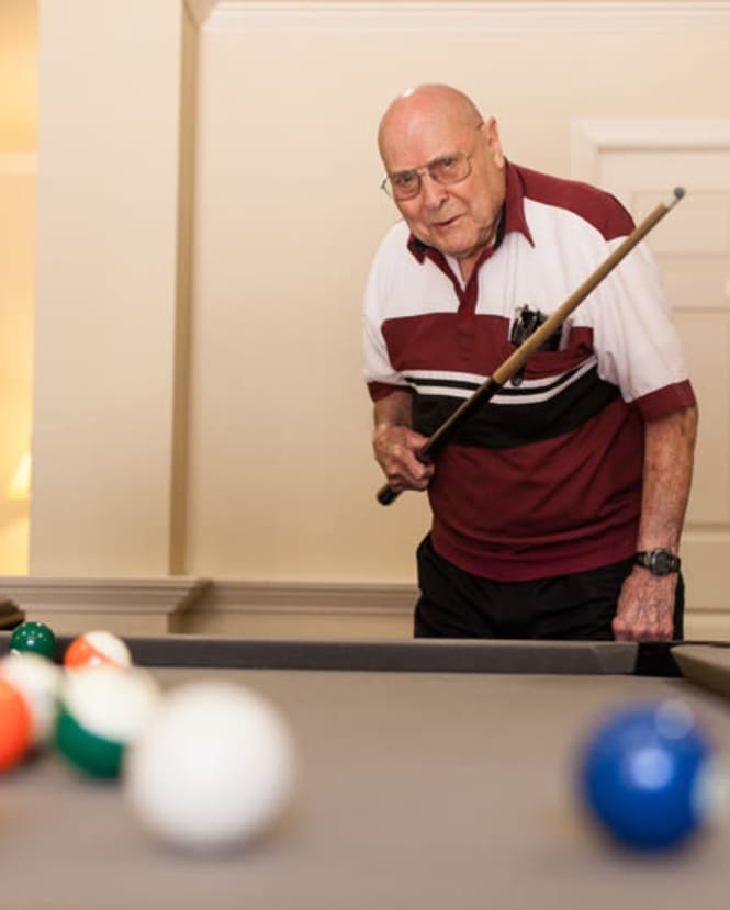 Man playing billiards indoors