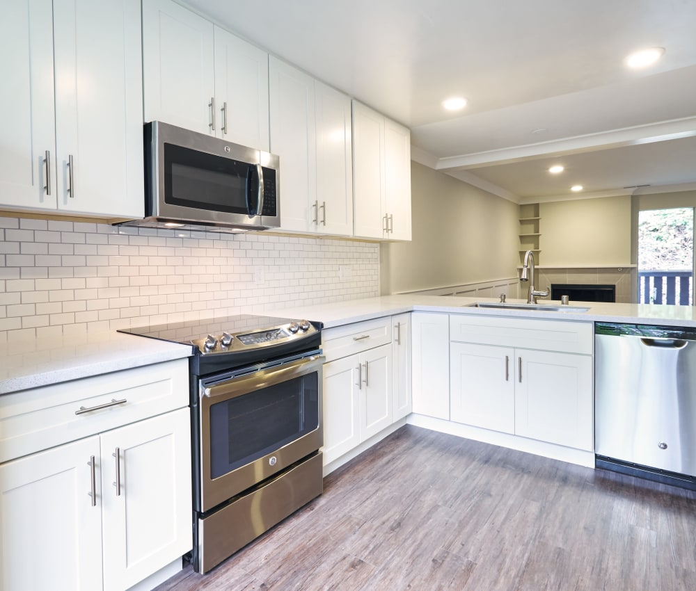 Kitchen with stainless steel appliances and wood floors at Ladera in Lafayette, California
