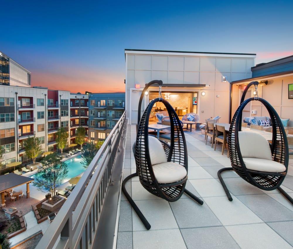 Lounge chairs on City View Vinings' sky deck patio in Atlanta, Georgia