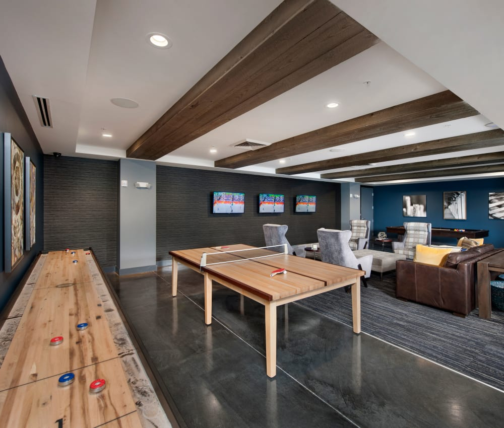Game area with shuffleboard table at City View Vinings in Atlanta, Georgia