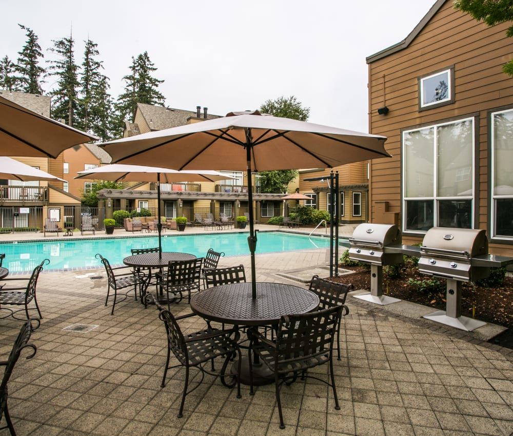 Poolside seating at The Colonnade Luxury Townhome Rentals in Hillsboro, Oregon