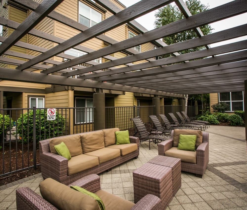 Lounge area by The Colonnade Luxury Townhome Rentals' swimming pool in Hillsboro, Oregon