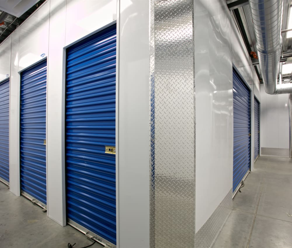 Storage units with blue doors at Pacific Highway Storage in San Diego, California