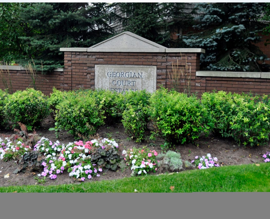 Monument sign at Georgian Court Estates in Burlington