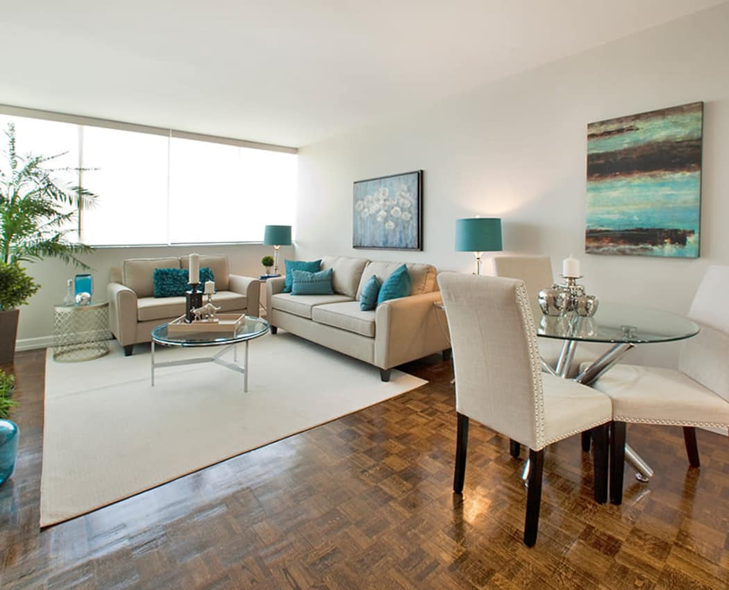Naturally well-lit living room and dining room at apartments at Applewood on the Park  in Mississauga, Ontario
