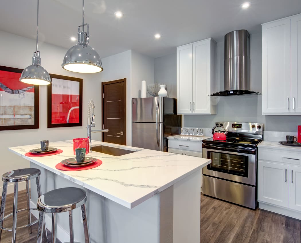 Kitchen w/ island at Empire | Apartments in Henderson, Nevada