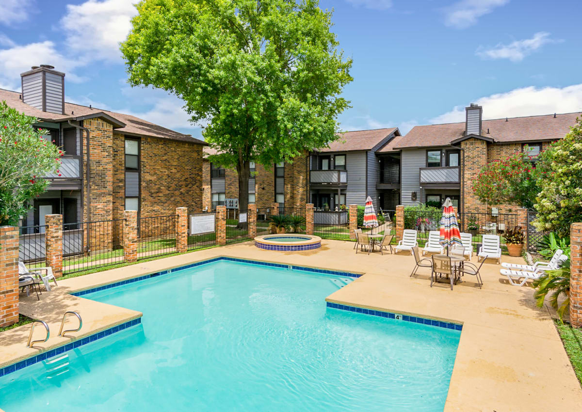 Gorgeous swimming pool area with plenty of seating at North Pointe Apartments in Bossier City