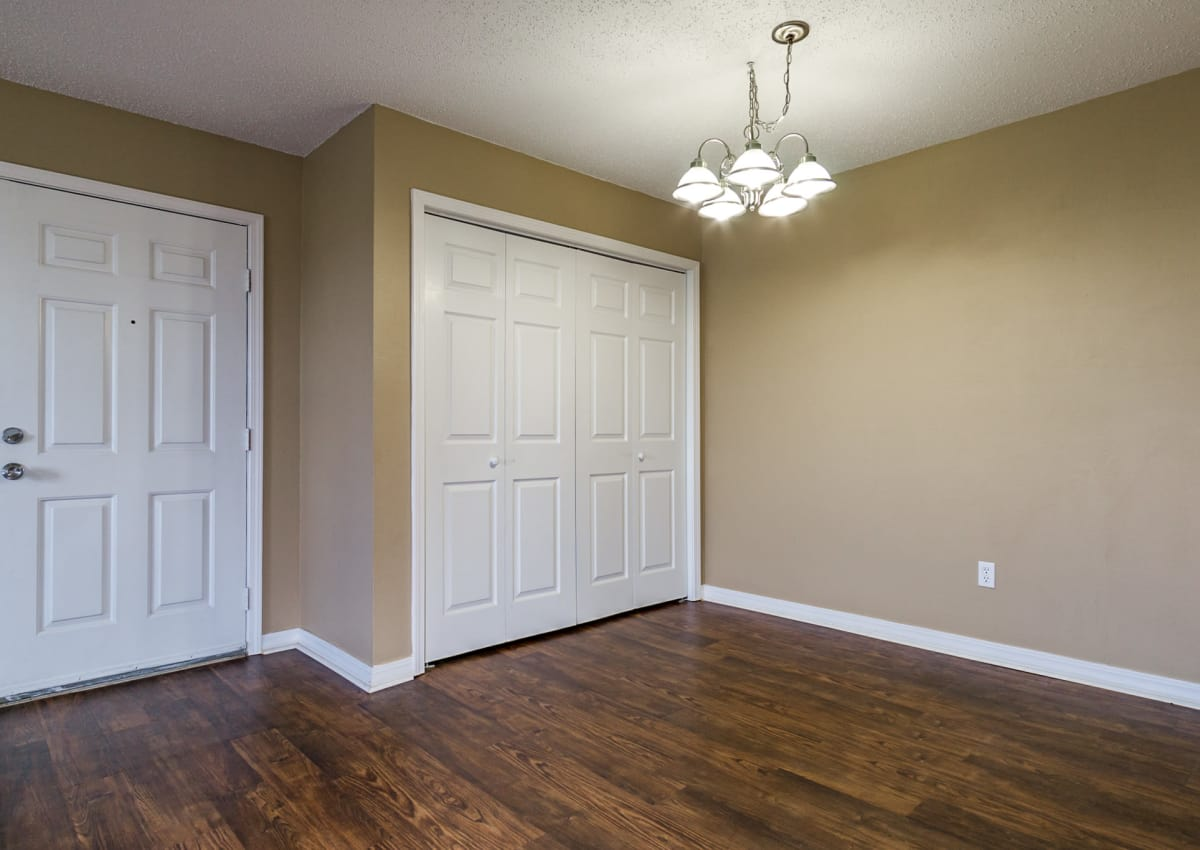 Master bedroom at North Pointe Apartments with plenty of closet space and hardwood floor