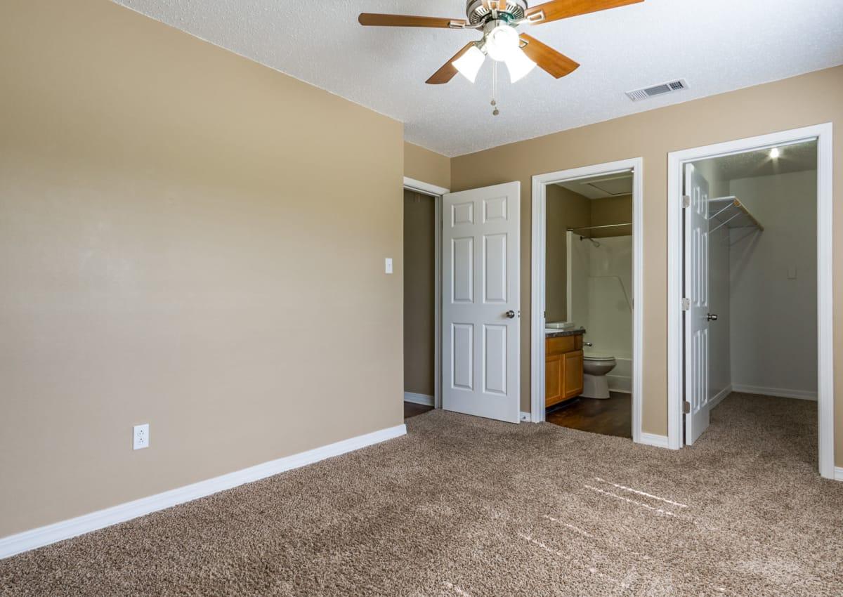Plush carpet in model bedroom at North Pointe Apartments, with view of ensuite bathroom and walk-in closet