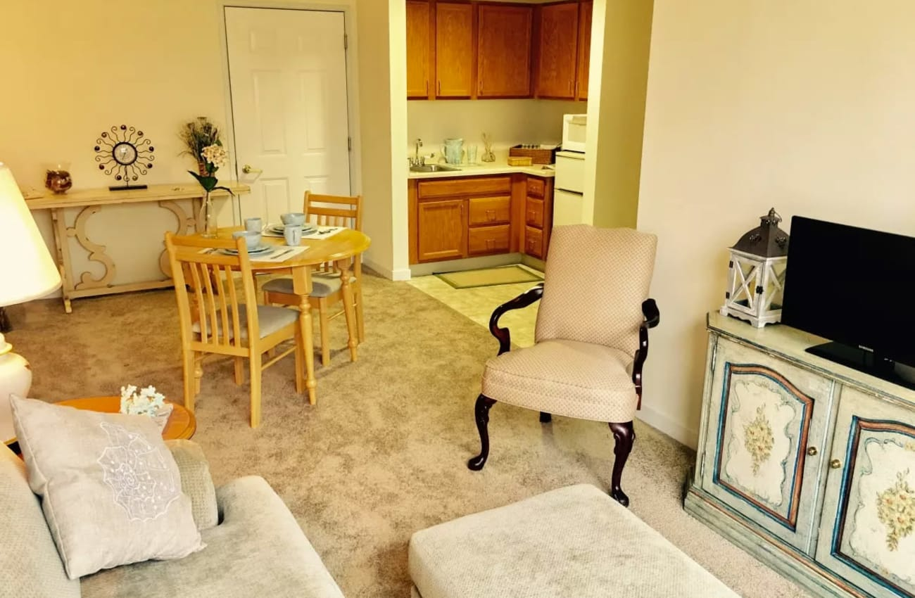 Assisted living apartment living area at Mattison Crossing at Manalapan Avenue in Freehold, New Jersey