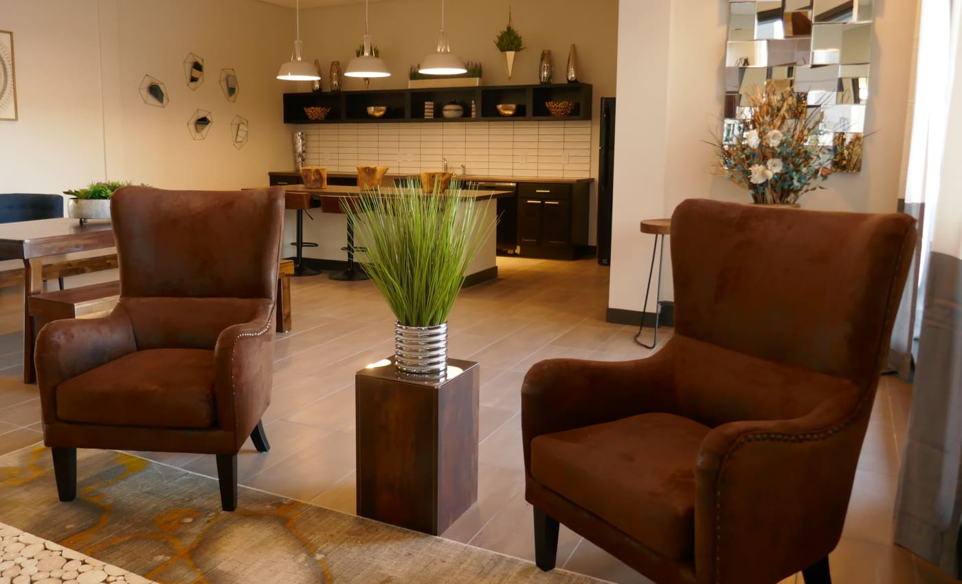 Comfortable chairs and warm lighting in the resident clubhouse at ALTO in Westminster, Colorado
