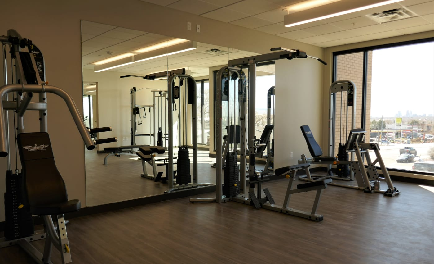 Strength training equipment in the fitness center at ALTO in Westminster, Colorado