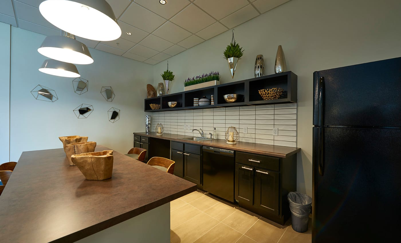 Fully equipped kitchen for residents' use in the clubhouse at ALTO in Westminster, CO