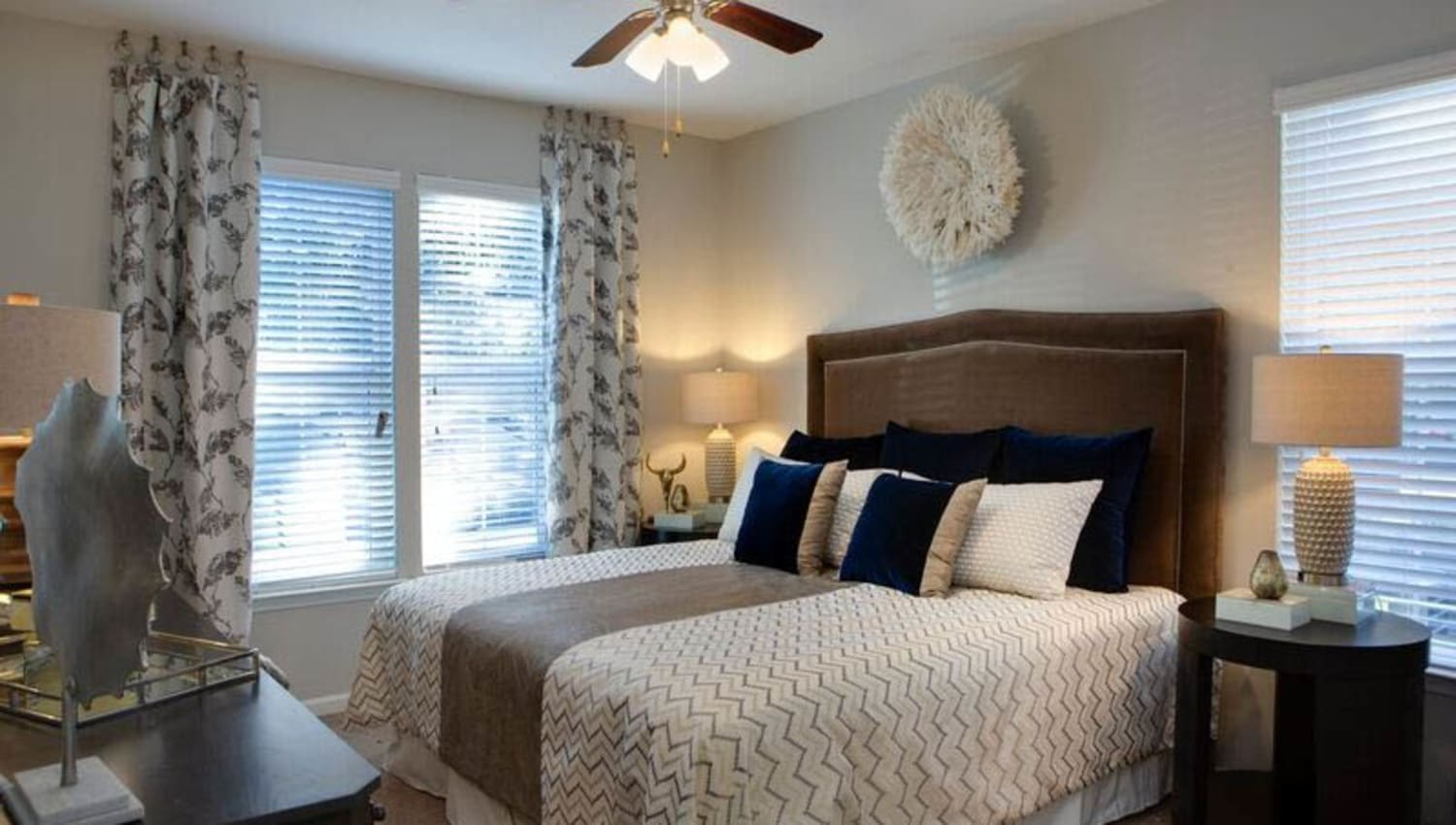 Well-furnished master bedroom in a model home at Canopy at Citrus Park in Tampa, Florida