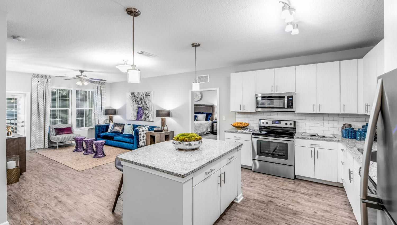 Gourmet kitchen with an island and granite countertops in a model home at Canopy at Citrus Park in Tampa, Florida