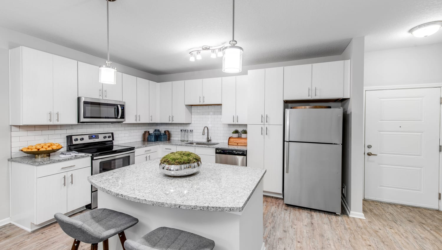 Stainless-steel appliances in a model apartment's kitchen at Canopy at Citrus Park in Tampa, Florida