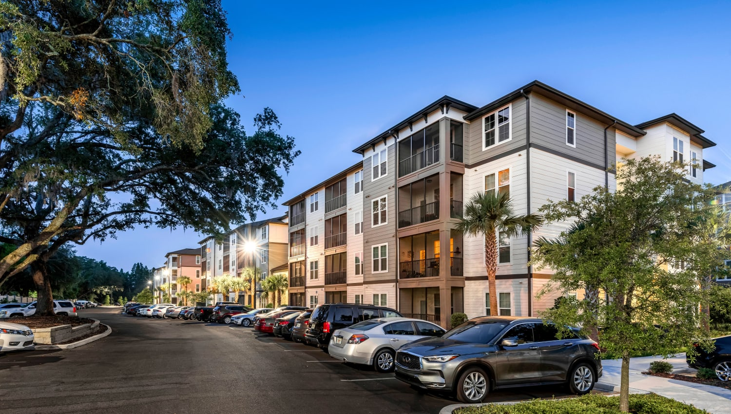 Parking lot and resident buildings in the evening at Canopy at Citrus Park in Tampa, Florida