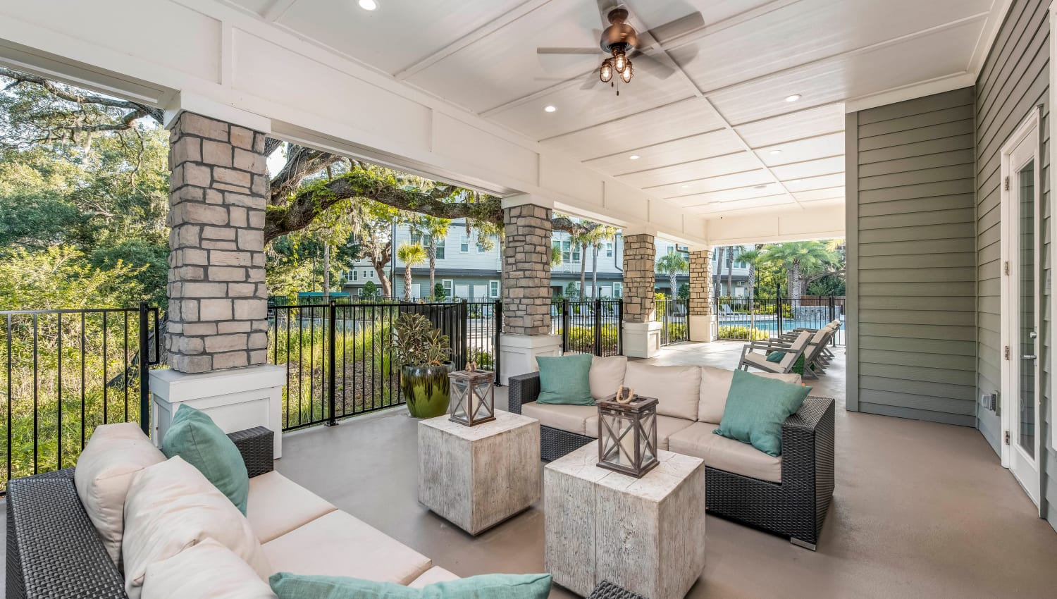 Covered outdoor lounge with a ceiling fan at Canopy at Citrus Park in Tampa, Florida
