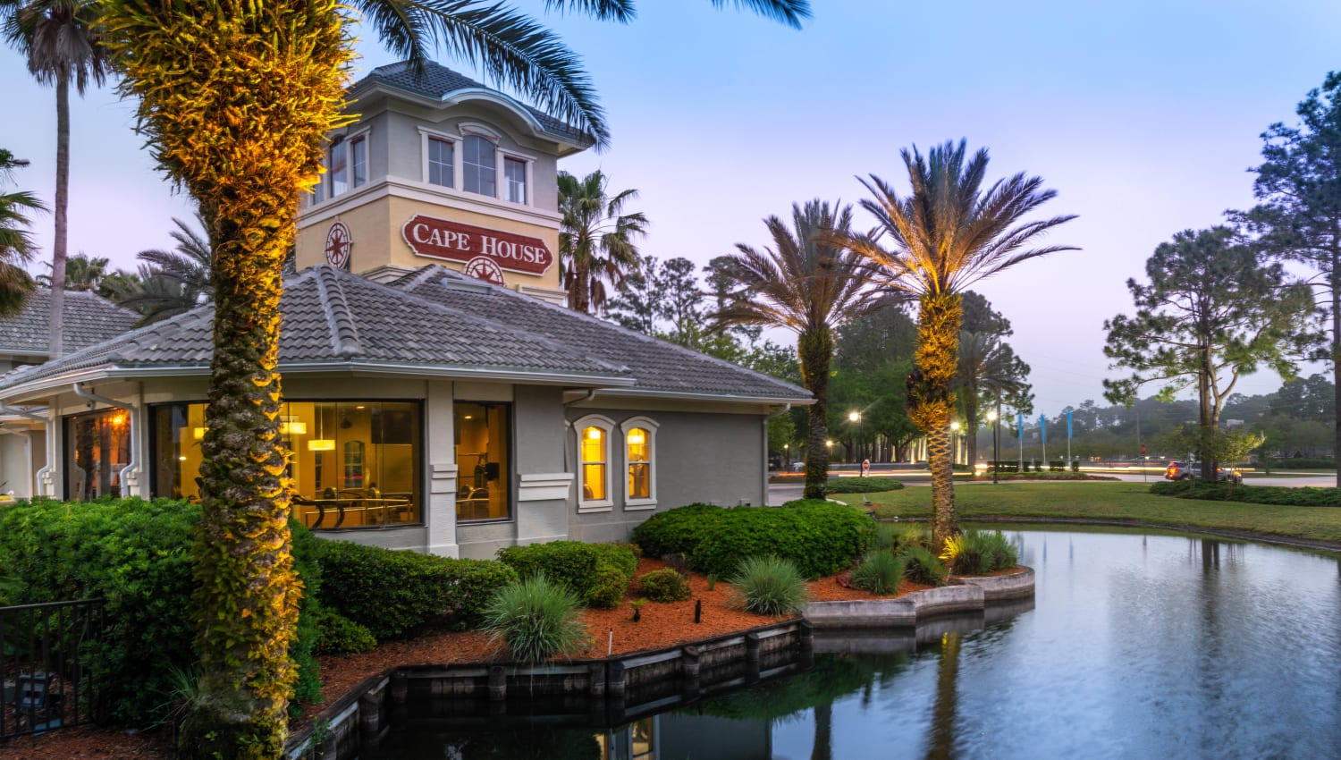 Early evening view of the clubhouse on the lake at Cape House in Jacksonville, Florida
