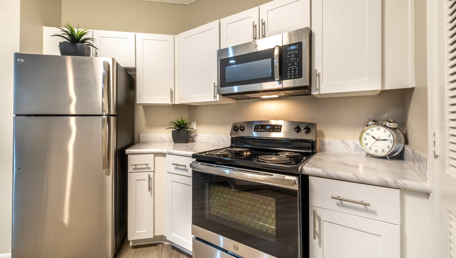 Stainless-steel appliances and granite countertops in a model home's kitchen at Cape House in Jacksonville, Florida