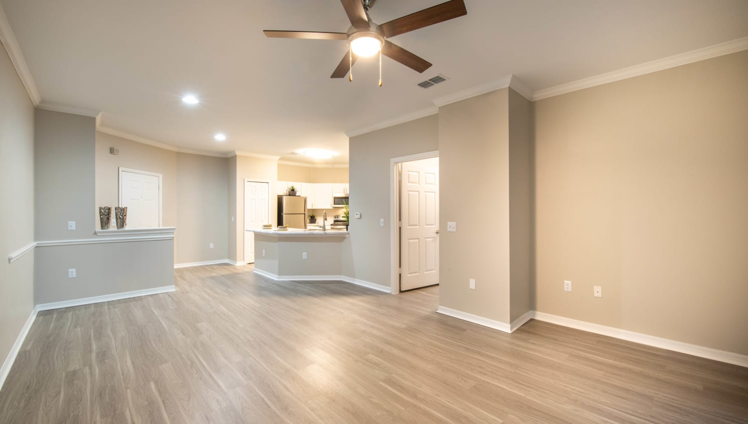 Ceiling fan and hardwood flooring in a model home's living area at Cape House in Jacksonville, Florida