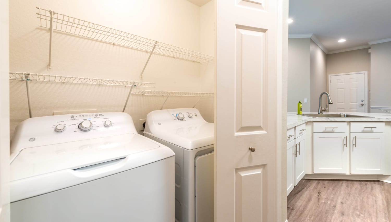 In-unit full-size washer and dryer in a model home at Cape House in Jacksonville, Florida