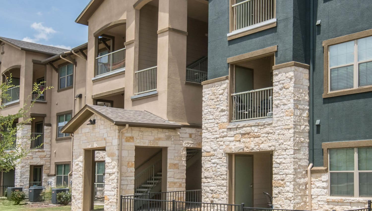 Exterior view of resident buildings at Carrington Oaks in Buda, Texas