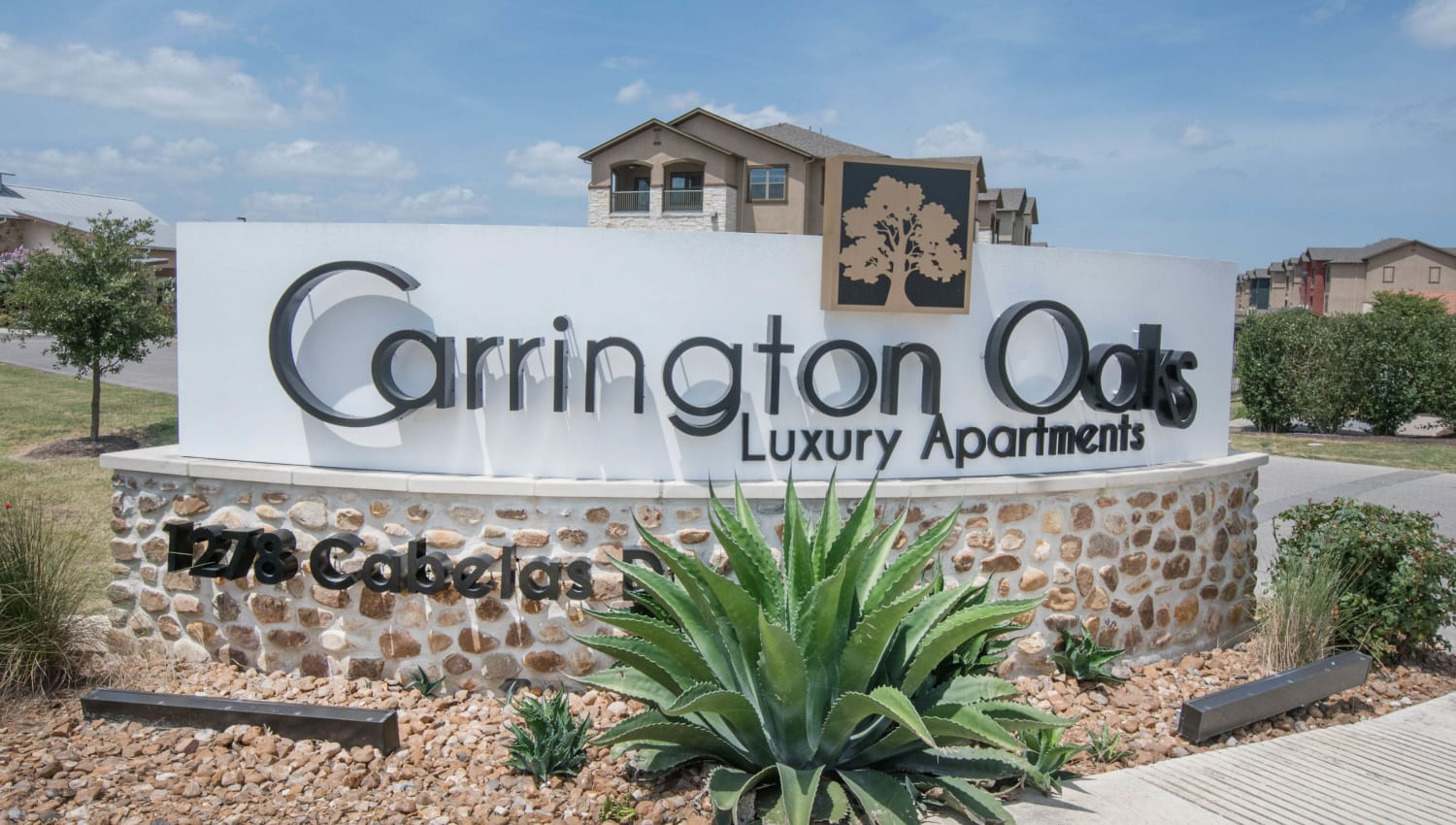 Our sign welcoming residents and their guests to Carrington Oaks in Buda, Texas