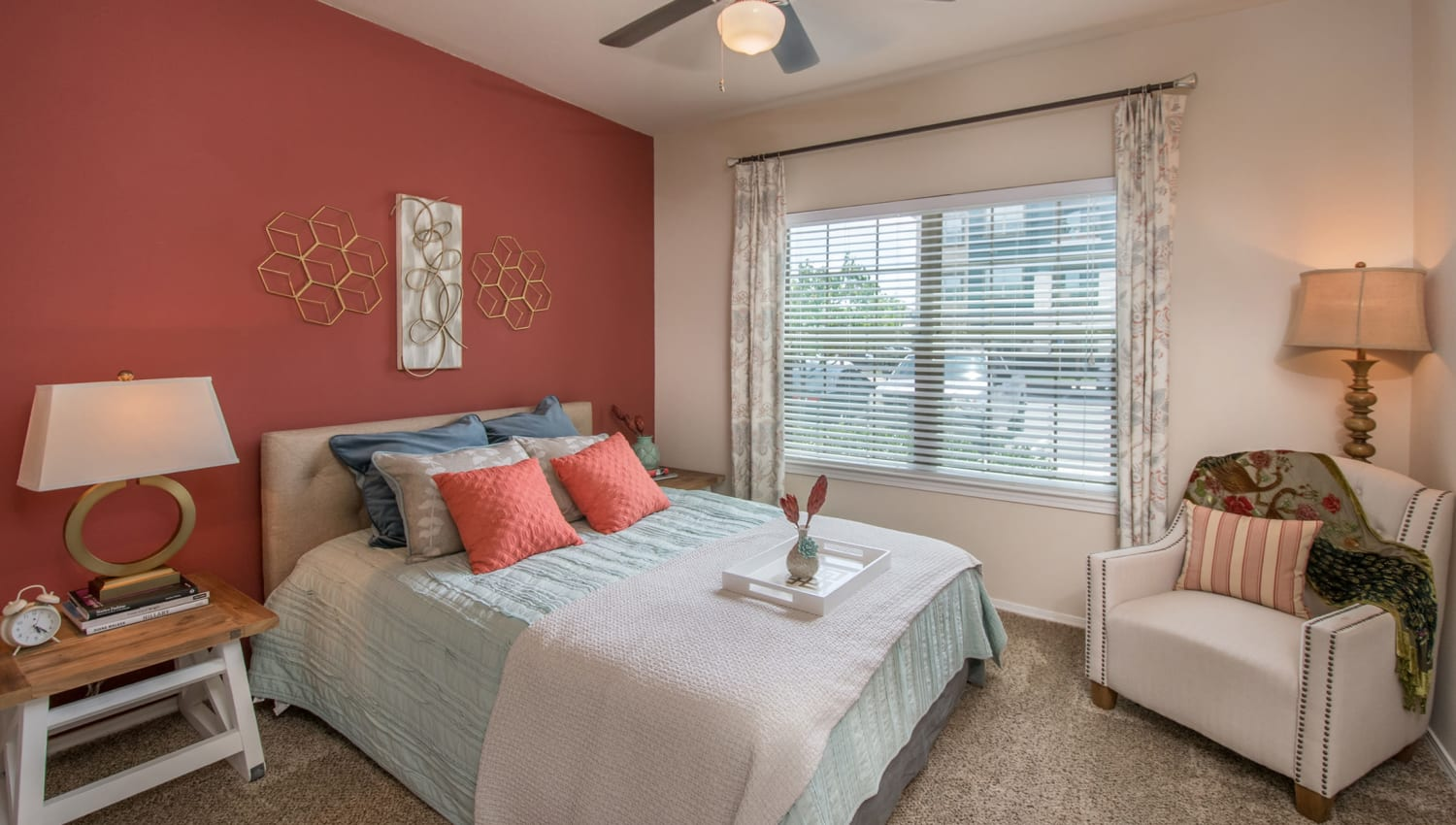 Ceiling fan and plush carpeting in the master bedroom of a model home at Carrington Oaks in Buda, Texas