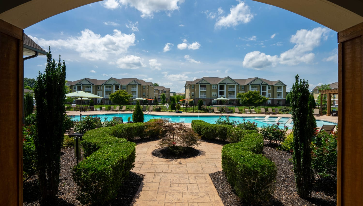 Professionally groomed shrubbery at the entrance to the pool area at Legends at White Oak in Ooltewah, Tennessee
