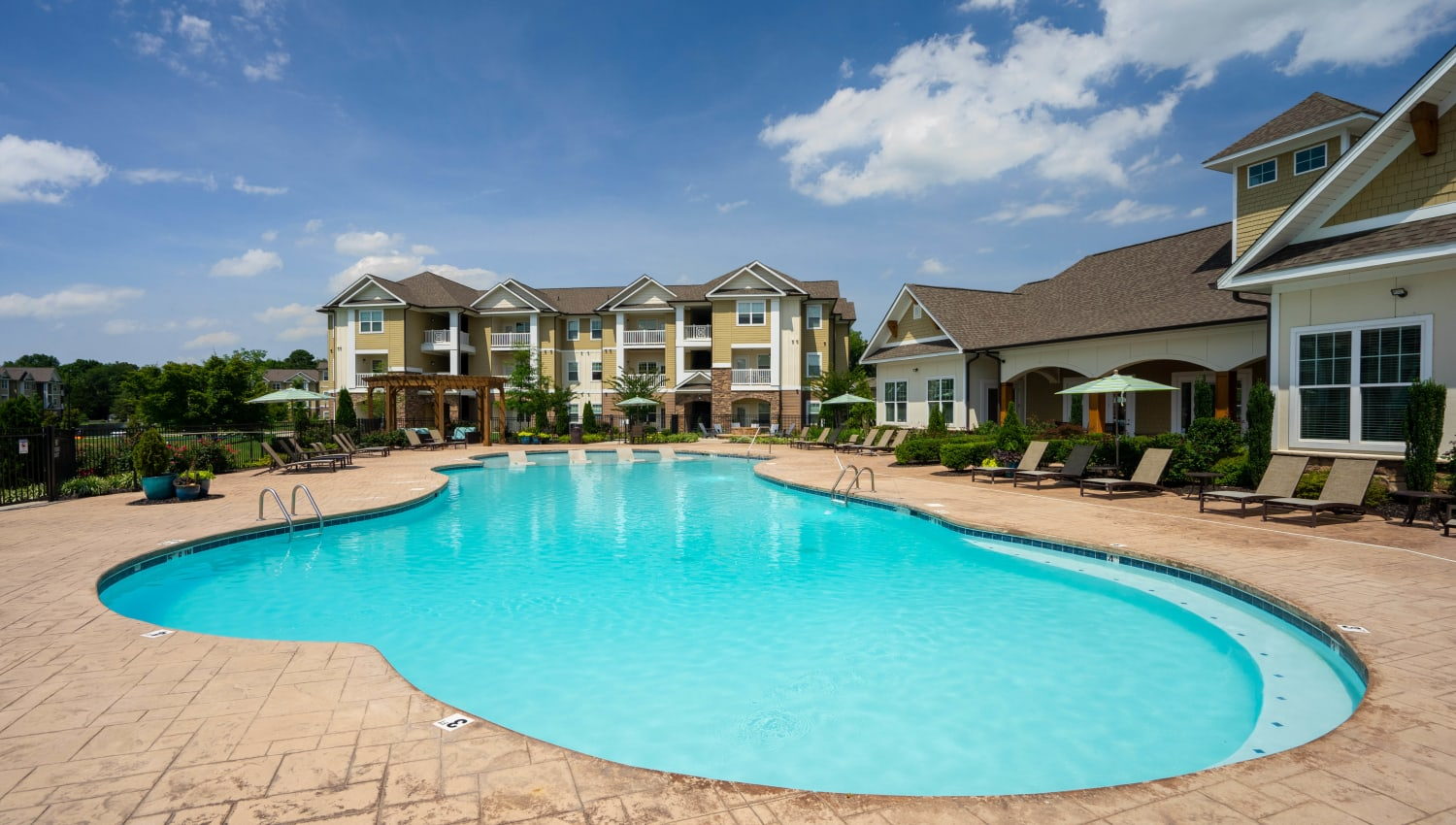 Sparkling swimming pool on a beautiful day at Legends at White Oak in Ooltewah, Tennessee