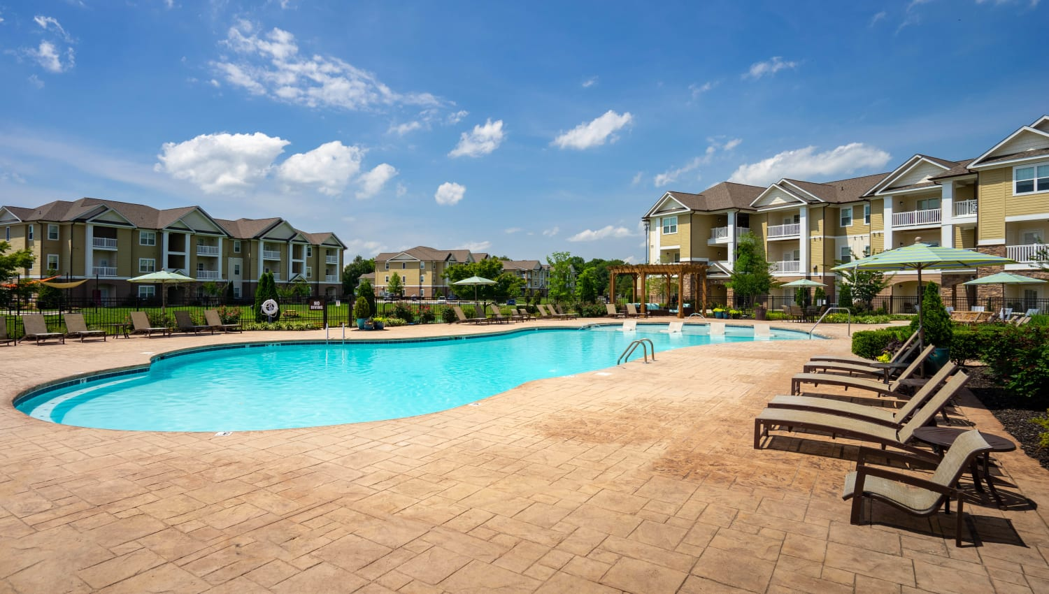 Chaise lounge chairs near the pool at Legends at White Oak in Ooltewah, Tennessee