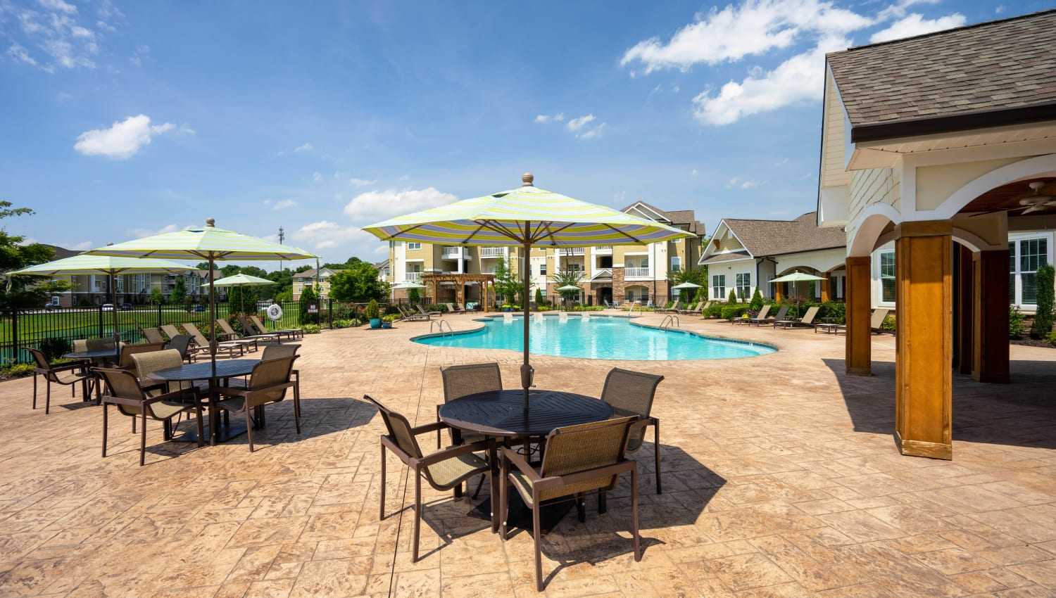 Shaded seating near the pool at Legends at White Oak in Ooltewah, Tennessee